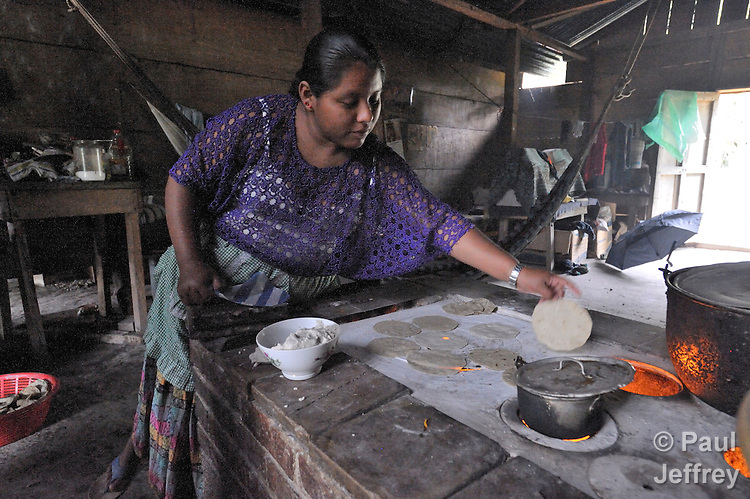 A woman prepares tortillas in her home in the Guatemalan village of Santa Elena, located in the Peten region along the Salinas River where it forms a border with Mexico.
