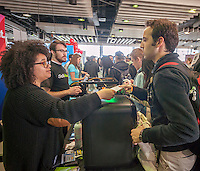 A job seeker, right, hands his resume to a Solidoodle employee at the TechDay New York event on Thursday, April 23, 2015. Thousands attended to seek jobs with the startups and to network with their peers. TechDay bills itself as the world's largest startup event with over 300 exhibitors. (© Richard B. Levine)