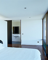 In this minimal white bedroom design takes precedence over decoration
