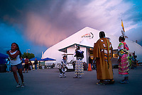 Native American dancers from several area tribes await ttheir performances outside a powow on the Southern Ute reservation at Ignacio, Colo., Friday, June 15, 2007. The Southern Ute tribe has taken good financial advantage of natural gas reserves on it's land and the surrounding area. Money has been putr to use for community services as well as dividend distribution to tribe members. (Kevin Moloney for the New York Times)