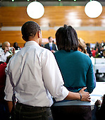 Washington, DC - January 19, 2009 -- United States President-elect Barack Obama and Michelle Obama stand together as volunteers at Calvin Coolidge High School work on various projects supporting the troops  in Washington, D.C., U.S., Monday, Jan. 19, 2009.    .Credit: Joshua Roberts - Pool via CNP