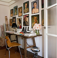 A collection of portraits found in flea-markets displayed on the wall of the study/guest room