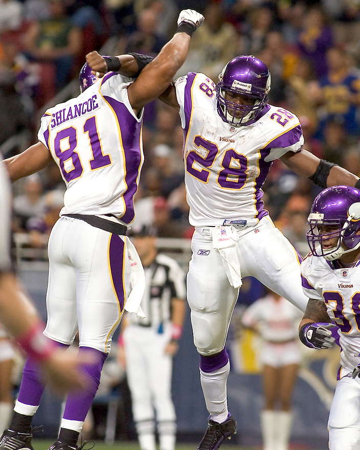 October 11, 2009 - St Louis, Missouri, USA - Vikings running back Adrian Peterson (28) celebrates a touchdown with tight end Visanthe Shiancoe (81) in the game between the St Louis Rams and the Minnesota Vikings at the Edward Jones Dome.  The Vikings defeated the Rams 38 to 10.  .