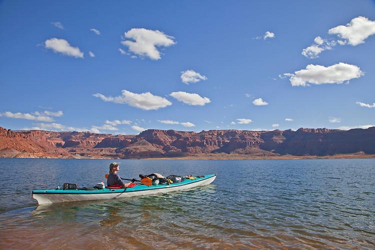 Jacque Miniuk kayaks in Good Hope Bay on Lake Powell in the Glen Canyon National Recreation Area, Utah