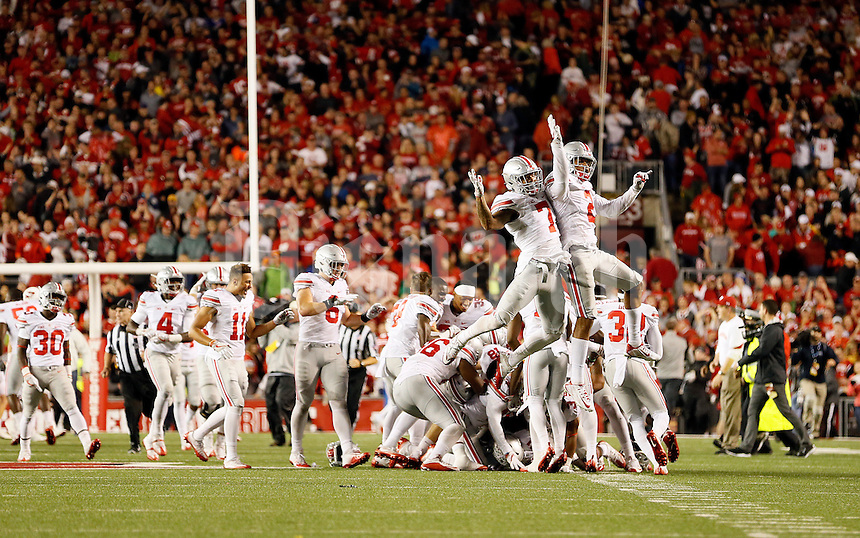 Ohio State Buckeyes cornerback Damon Webb (7) and cornerback Marshon Lattimore (2) celebrate their win over the Wisconsin Badgers following the overtime of the NCAA football game at Camp Randall Stadium in Madison, Wisconsin on Oct. 15, 2016. Ohio State won 30-23. (Adam Cairns / The Columbus Dispatch)