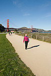 San Francisco, California, Woman enjoying Crissy Field east of the Golden Gate Bridge along the Golden Gate Promenade.  Photo copyright Lee Foster.  Photo #  1-casanf76360