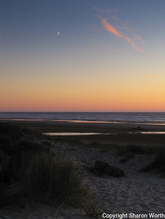 A crescent moon, a wisp of cloud and sunset's glow - Haceta Beach, Florence, Oregon.