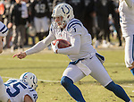 Indianapolis Colts punter Pat McAfee (1) keeps ball in fake field goal kick on Saturday, December 24, 2016, at O.co Coliseum in Oakland, California.  The Raiders defeated the Colts 33-25.