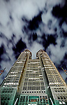 The Tokyo metropolitan Government building at night with clouds showing the light poluution that is a feature and problem in Tokyo. Japan April 11th 2007`
