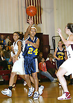 WATERBURY, CT,  02 JANUARY 2006, 010207BZ16- Kennedy's Antonia Stallings (24) passes the ball against Sacred Heart during their game at Sacred Heart High School in Waterbury Tuesday.<br /> Jamison C. Bazinet Republican-American