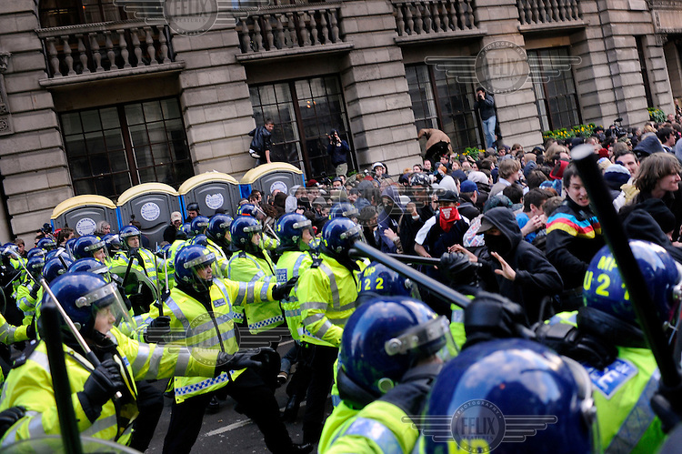 Police charge demonstrators as thousands of protestors descended on the City of London ahead of the G20 summit of world leaders to express anger at the economic crisis, which many blame on the excesses of capitalism.