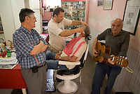 Pizzo, Calabria, May 2007.Get your shave by the local barber while local celebrity Lino Vallone plays his guitar. Many picturesque towns line the mountainous coastline if Calabria. Photo by Frits Meyst/Adventure4ever.com