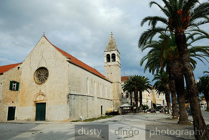 Church, Sveti Duje (Saint Dominic) Monastery and palm tree lined avenue. Trogir, Croatia