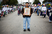 A large procession of worshipers celebrating the Virgin of Guadalupe wound through the streets of the Birch Avenue neighborhood near the Immaculate Conception Catholic Church in Durham, Dec. 12, 2009.