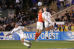 14 December 2007: Virginia Tech's Alexander Baden (GER) (2) and Wake Forest's Zack Schilawski (12) challenge for a header as Jamie Franks (11) watches. The Wake Forest University Demon Deacons defeated the Virginia Tech University Hokies 2-0 at SAS Stadium in Cary, North Carolina in a NCAA Division I Men's College Cup semifinal game.