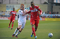 Chicago defender Cory Gibbs (5) holds off Toronto defender Richard Eckersley (27).  The Chicago Fire defeated Toronto FC 2-0 at Toyota Park in Bridgeview, IL on August 21, 2011.