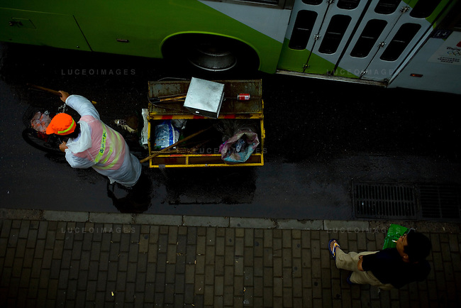 A garbage collector rides his route in Beijing, China on Thursday, August 21, 2008.  Kevin German