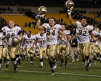 Navy Midshipmen Paul Bridgers #66, Matt Wimsatt #54, Chris  Kuhar-Pitters #92 and Ryan Griffith #91 run off of the field celebrating after the Navy Midshipmen beat the Pitt Panthers 48-45 in double overtime on October 10, 2007 at Heinz Field, Pittsburgh, Pennsylvania.
