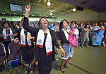 Participants, including these newly consecrated deaconesses, sing during an April 27, 2014, worship service at the United Methodist Women's Assembly in Louisville, Kentucky.