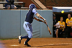 CHAPEL HILL, NC - FEBRUARY 24: UNC's Hailey Cole hits a game-winning walk off sacrifice fly in the bottom of the ninth inning. The University of North Carolina Tar Heels played the Towson University Tigers on February, 24, 2017, at Anderson Softball Stadium in Chapel Hill, NC in a Division I College Softball match. UNC won the game 6-5 in nine innings.