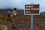 Don o'Driscoll, JMT, with spoof Deer Forest sign, Quinag, Scotland