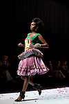 CAPE TOWN, SOUTH AFRICA - AUGUST 13: A model walks on the catwalk with one outfit of Stoned Cherrie, a fashion label, at the African Fashion International Cape Town fashion week on August 13, 2010, at the Cape Town International Convention Center, in Cape Town, South Africa. Stoned Cherrie is founded by Nkhensani Nkosi, age 37, a mother of four and a celebrated fashion designer, entrepreneur, television personality and an actress in South Africa. She launched her new collection Love Movement at this event. (Photo by Per-Anders Pettersson)