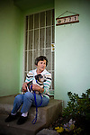 Carol Couts poses for a portrait with her dog Ollie at her Yuba City, California home April 6, 2009. Couts is awaiting eviction from the home she has owned for over 30 years.