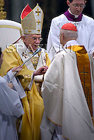 Cardinal Angelo Bagnasco;newly elevated cardinal attends a Mass celebrated by Pope Benedict XVI, seen in the background wearing yellow, in which he gave each new cardinal a golden ring, inside St. Peter's Basilica, at the Vatican, Sunday, Nov. 25, 2007.