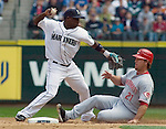 After forcing out Cincinnati Reds base runner Scott Hatteberg at second, Seattle Mariners' shortstop Yuniesky Betancourt tries for a double play in the third inning at Safeco Field in Seattle on June 24, 2007.  Red's Brandon Phillips hit into a double play. The Mariners beat the Reds 3-2.   Jim Bryant Photo. ©2010. ALL RIGHTS RESERVED.