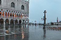 The Doge's Palace or Palazzo Ducale, begun 1340 and built in Venetian Gothic style, on the Piazzetta San Marco, between the Piazza San Marco and the Venetian lagoon, Venice, Italy. The palace has 2 arcades with 14th and 15th century capitals and sculptures, and a loggia above with a decorative brickwork facade. It was the residence of the Doge of Venice, the supreme authority of the former Republic of Venice, until the Napoleonic occupation in 1797, and is now a museum. To the right is the Column of San Marco, with a statue of St Mark the evangelist in the form of a winged lion, 12th century, by Nicolo Barattieri. The city of Venice is an archipelago of 117 small islands separated by canals and linked by bridges, in the Venetian Lagoon. The historical centre of Venice is listed as a UNESCO World Heritage Site. Picture by Manuel Cohen