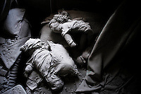 SYRIA - Al Qsair. Dolls in a destroyed house by a Syrian Army tank shell in Al Qsair, on January 25, 2012. Al Qsair is a small town of 40000 inhabitants, located 25Km south-west of Homs. The town is besieged since the beginning of November and so far it counts 65 dead. ALESSIO ROMENZI