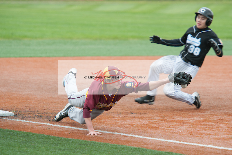Dimond's Kyle Bremont dives for a throw as Chugiak's Tristan Costanios slides into third base during the Mustangs' 11-10 loss to Dimond in the Region IV Baseball Championships Saturday.  Photo for the Star by Michael Dinneen