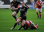 Shane Williams is tackled. Ospreys V Worcester Warriors, EDF Energy Cup © Ian Cook IJC Photography iancook@ijcphotography.co.uk www.ijcphotography.co.uk