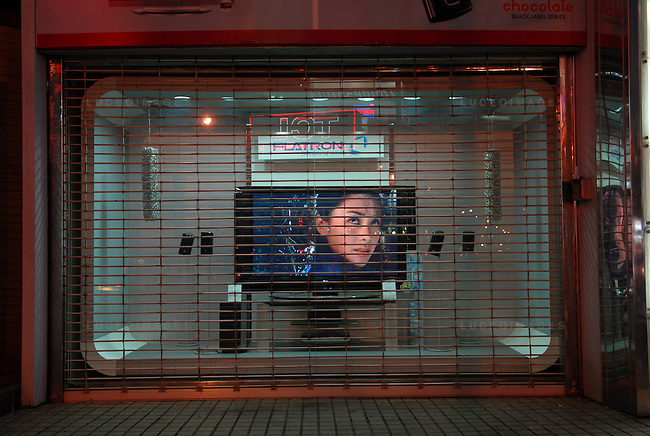 A movie plays on a tv set at an electronics store in Ho Chi Minh City, Vietnam.