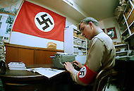 February 10, 1972, Arlington, Virginia. At the headquarters of the White National Socialist Party, one member is a secratary and handle the relation with the members.