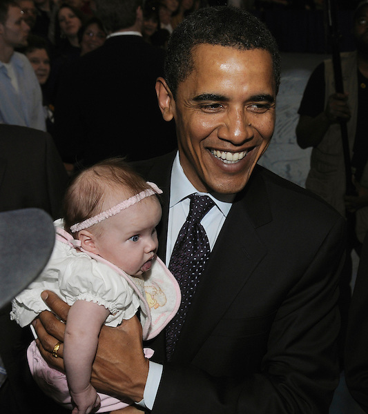 Johnstown, Pennsylvania: March 29, 2008.Presidential candidate Barack Obama holds a baby at the conclusion of a campaign town hall meeting held inside a gymnasium at Greater Johnstown High School. ©Christopher Fitzgerald / CandidatePhotos.com