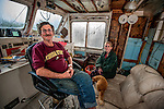 Commissioned work for the Working Wakulla Waterfront<br /> <br /> 67 year-old Lawrence Snodgrass and his daughter-in-law Tiffany Johnson live on Snodgrass's 1967 boat &quot;Sprong&quot; where's he's lived for the past three years in St Marks, FL .   Snodgrass just returned home after a couple of days in the hospital from a leg injury he received repairing his boat.