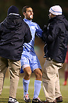 25 November 2012: UNC's Raby George (SWE) (33) is helped to his feet by trainers after being injured. The University of North Carolina Tar Heels played the Farleigh Dickinson Knights at Fetzer Field in Chapel Hill, North Carolina in a 2012 NCAA Division I Men's Soccer Tournament third round game. UNC won the game 1-0 in overtime.