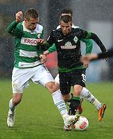 Fussball 1. Bundesliga :  Saison   2012/2013   9. Spieltag  27.10.2012 SpVgg Greuther Fuerth - SV Werder Bremen Milorad Pekovic (li, Greuther Fuerth) gegen Lukas Schmitz (SV Werder Bremen)