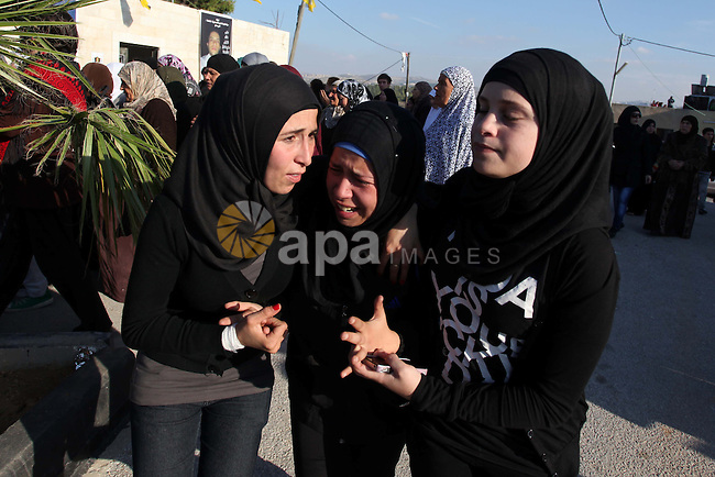 Relatives grieve Rushdi Tamimi who died of injuries sustained during clashes Saturday with Israeli security, during his funeral in the West Bank city of Ramallah, Tuesday, Nov 20, 2012. Tamimi was wounded during a protest against Israel's operation in Gaza on Saturday, Nov. 17, 2012. Efforts to end a week-old convulsion of Israeli-Palestinian violence drew in the world's top diplomats on Tuesday, with President Barack Obama dispatching his secretary of state to the region on an emergency mission and the U.N. chief appealing from Cairo for an immediate cease-fire. Photo by Issam Rimawi
