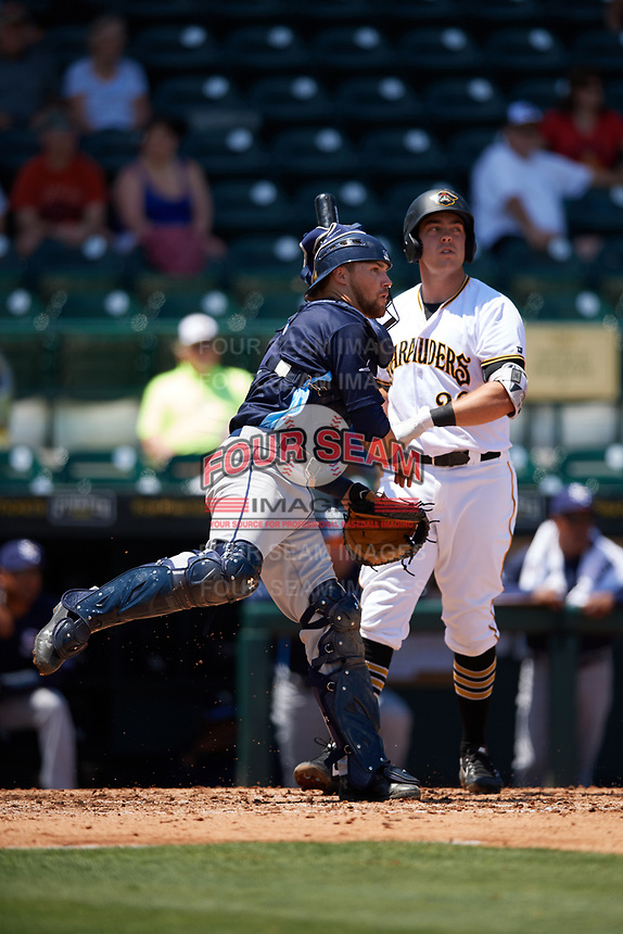 Charlotte Stone Crabs catcher Brett Sullivan (8) throws down to second base in front of batter Will Craig (22) during a game against the Bradenton Marauders on April 9, 2017 at LECOM Park in Bradenton, Florida.  Bradenton defeated Charlotte 5-0.  (Mike Janes/Four Seam Images)