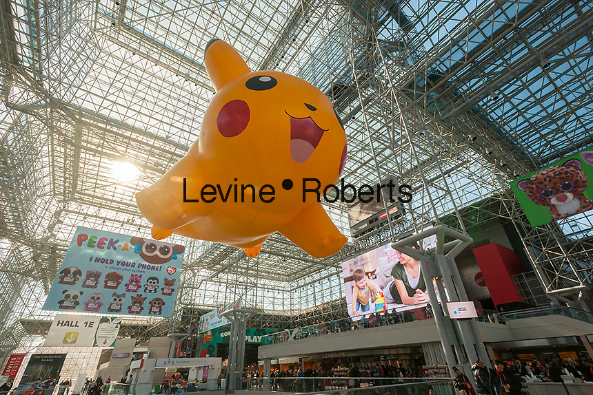 A Pokemon balloon floats above the 113th North American International Toy Fair in the Jacob Javits Convention center in New York on Sunday, February 14, 2016.  The four day trade show with over 1000 exhibitors connects buyers and sellers and draws tens of thousands of attendees.  The toy industry generates over $84 billion worldwide and Toy Fair is the largest toy trade show in the Western Hemisphere. (© Richard B. Levine)