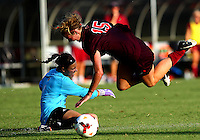 WINSTON-SALEM, NORTH CAROLINA - August 30, 2013:<br />  Paige Brown (1) of Louisville University knocks Ashley Meier (15) of Virginia Tech off the ball during a match at the Wake Forest Invitational tournament at Wake Forest University on August 30. The game ended in a 1-1 tie.