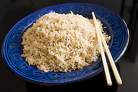 Bowl of brown wholegrain rice and chopsticks. Rice has become an expensive commodity as its in short supply.