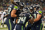 Seattle Seahawks celebrates with running back Thomas Rawls in the end zone after scoring a touchdown against the Denver Broncos during the fourth quarter at CenturyLink Field on August 14, 2015 in Seattle Washington.  Rawls run for a touchdown on a 19-yard pass from quarterback A.J. Archer. The Broncos beat the Seahawks 22-20.  © 2015. Jim Bryant Photo. All Rights Reserved.