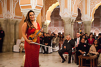 Australian violinist Niki Vasilakis announces a piece before she plays the violin during a recital at the OzFest Gala Dinner in the Jaipur City Palace, in Rajasthan, India on 10 January 2013. Photo by Suzanne Lee