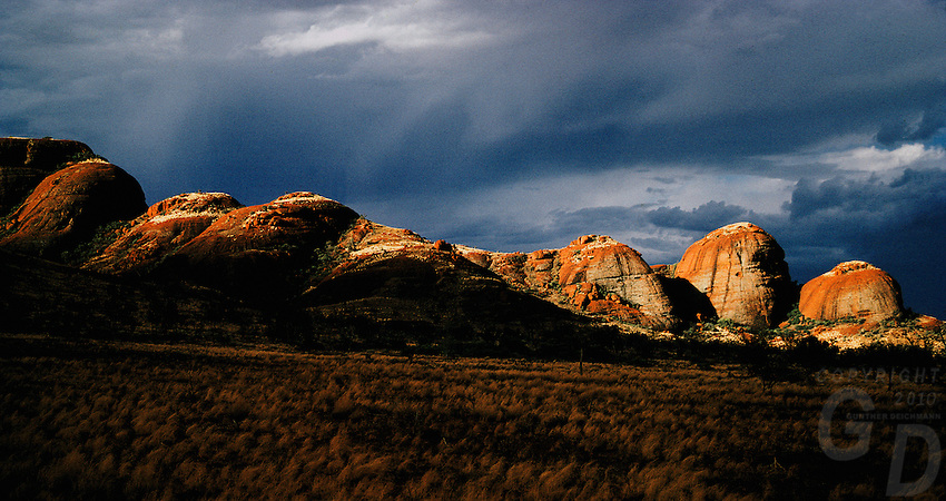 The Olgas in Uluru National Park during sunset and approaching storm, Central Australia