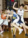 WATERBURY, CT,  02 JANUARY 2006, 010207BZ15- Kennedy's Jaleesa Roy (25) drives past Sacred Heart's Maisie Sanchez (20) during their game at Sacred Heart High School in Waterbury Tuesday.<br /> Jamison C. Bazinet Republican-American