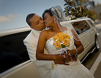 A bride and groom kiss after their wedding at Scottish Rite Temple in Oakland on June 24, 2011