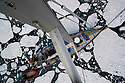 Norway, Svalbard, view onto boat Arctica surrounded by drift ice  in fjord from 20 m high mast